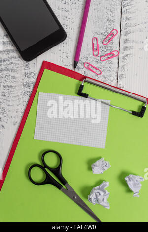 Clipboard paper sheet pencil smartphone scissors note clips balls wooden - Stock Photo