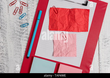 Clipboard sheet crushed sticky note clip notepads marker wooden background - Stock Photo