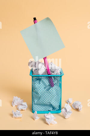crumpled paper trash and stationary with note paper placed in the trash can - Stock Photo