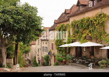 Old cliffside town, a member of 'The most beautiful villages of France', Saint-Cirq-Lapopie, France - Stock Photo