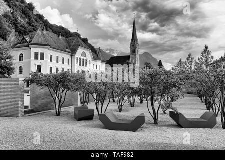 Vaduz, Liechtenstein. Old building of parliament and Cathedral of St. Florin in  Vaduz, Liechtenstein. - Stock Photo