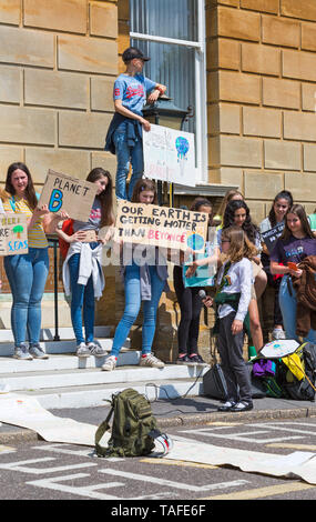 Bournemouth, Dorset, UK. 24th May 2019. Youth Strike 4 Climate gather in Bournemouth Square with their messages about climate change, before marching to the Town Hall where a long letter on wallpaper roll signed by supporters was received by Simon Bull.  Our Earth is getting hotter than Beyonce sign. Credit: Carolyn Jenkins/Alamy Live News - Stock Photo
