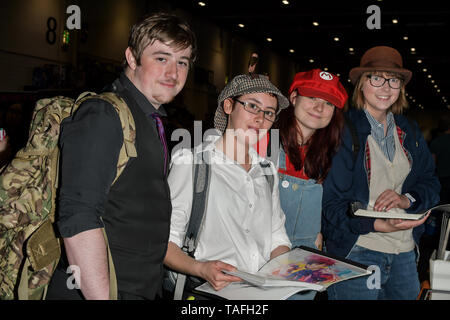 Comic fans looking at a stall GuiZang (www.guizang.co.uk) by artist Qing Qi at MCM Comic Con London on May 24, 2019. Credit: Picture Capital/Alamy Live News - Stock Photo