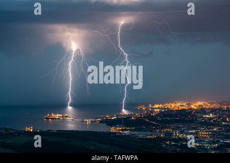 Two branching lightning strikes in Trieste (Italy). Two lightning strikes branched to Trieste, during the very electric storm of August 25, 2018 - Stock Photo