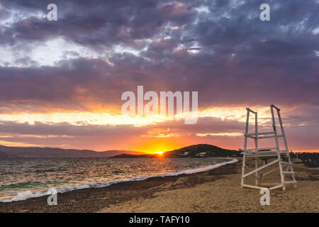 Sunset behind the Cyclades at Agios Prokopios beach, Naxos, Greece - Stock Photo