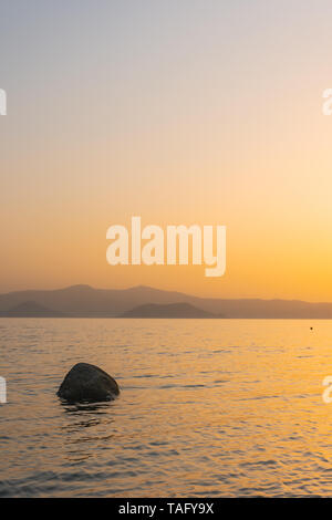 Sunset behind the Cyclades in the Aegean Sea, Naxos, Greece - Stock Photo