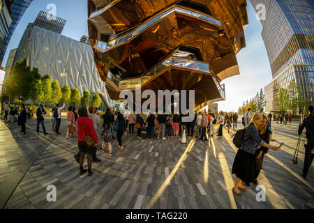 Hordes of visitors flock to Hudson Yards and The Vessel in New York on Tuesday, May 21, 2019. Retailers, including the Neiman Marcus department store, opened their shops in the development which was built on a platform over the West Side railroad yards. Office, residential, public space and retail space comprise the first phase in what is arguably the most expensive construction project ever built in the U.S.   (© Richard B. Levine) - Stock Photo