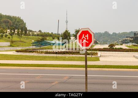 Pyongyang, North Korea - July 29, 2014: Road sign on the street in Pyongyang. - Stock Photo