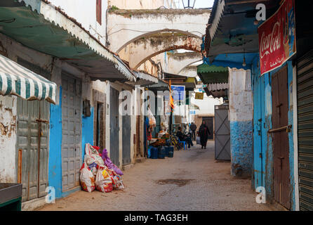 Narrow street with shops and blue and white painted houses in the old Rabat medina. Rabat, Morocco. - Stock Photo