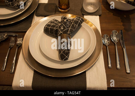 Dinner table. Serving set. Set of tableware. Served table. Dishes, napkins, forks, spoons, glasses on the table close up - Stock Photo