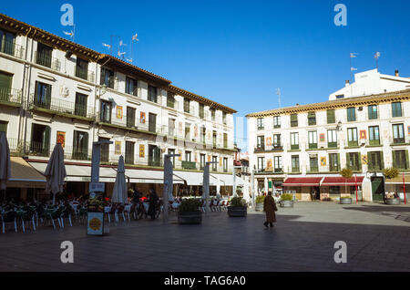 Tudela, Navarre, Spain - February, 13th, 2019 : Passersby at the 17th century Plaza Nueva or Plaza de los Fueros square, decorated with the coats of a - Stock Photo