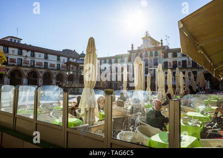 Tudela, Navarre, Spain - February, 13th, 2019 : People sit at outdoors cafes at the 17th century Plaza Nueva or Plaza de los Fueros square. - Stock Photo