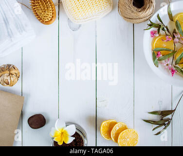 Homemade lemon essential oil, salt bath and fresh honey in the plate with honeycomb, dipper and mints on rustic background from top view. Flat lay goo - Stock Photo
