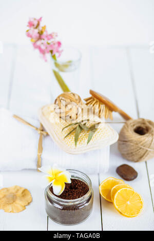 Body scrub of ground coffee aloe vera sugar and lemon on white background, homemade cosmetic for peeling and spa care,keep the moisture of your skin.G - Stock Photo