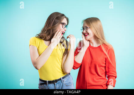 Two friends have fun talking, telling secrets, news to each other. Positive emotions, communication of the concept - Stock Photo