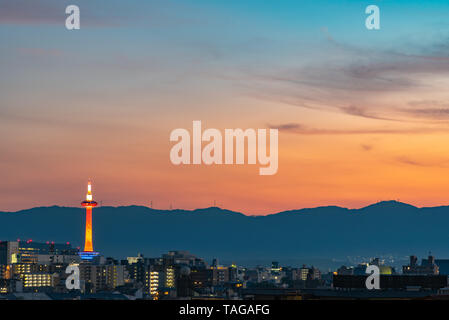 Colorful Kyoto Tower at night. Kyoto city skyline from above at dusk. - Stock Photo
