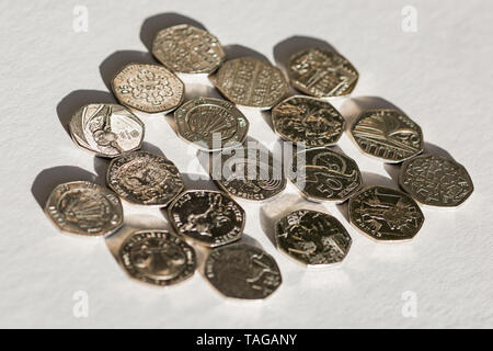 A collection of commemorative UK 50 pence coins. - Stock Photo