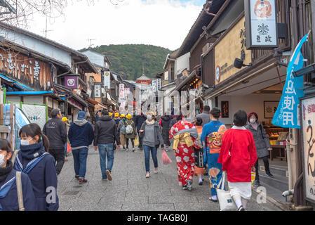 Crowded tourist on shopping street Matsubara-dori. Full of shops and restaurants near Kiyomizu-dera temple in Kyoto, Japan - Stock Photo