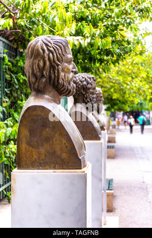 The statues of the three Greek tragic poets, Euripides, Sophocles and Aeschylus, located near the Syntagma square, Athens - Stock Photo