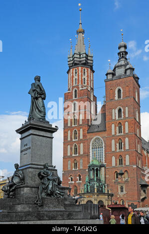 St. Mary's Basilica and the statue of Adam Mickiewicz Krakow Main market Square. Rynak Glowny. - Stock Photo