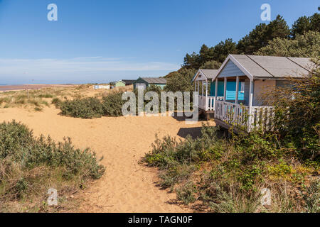beach huts in the sand dunes at old hunstanton on the north norfolk coast - Stock Photo