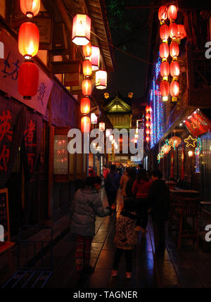Jinli Ancient Street in Chengdu, China.  Jinli Street has cafes and bars and is decorated with red lanterns. It's a fun place at night in Chengdu. - Stock Photo