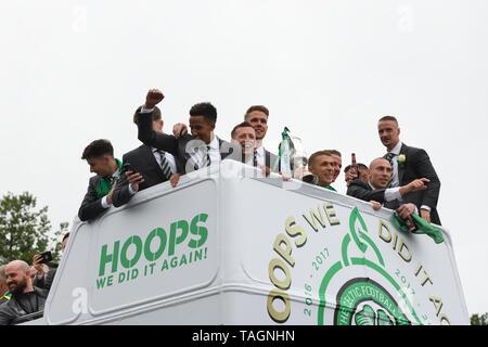 25th May, 2019. Glasgow, Scotland, UK, Europe. Scottish Cup winners, Celtic Football Club celebrate their achievement of three consecutive seasons of domestic trophy clean sweeps. The first time a domestic club has completed the triple treble in world football. Pictured are the club captain and players aboard and open top bus parade through the streets of Glasgow. - Stock Photo