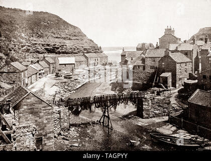 A late 19th Century view of  Staithes is a seaside village in the Scarborough Borough of North Yorkshire, England. At the turn of the century, there were 80 full-time fishing boats putting out from Staithes, but now it's largely a tourist destination within the North York Moors National Park. - Stock Photo