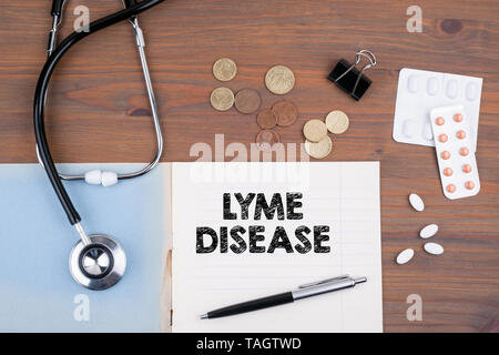 lyme disease. Doctor's desk with notebook - Stock Photo