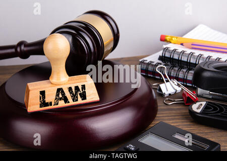 Law concept. Judge gavel and stationery on a wooden table - Stock Photo