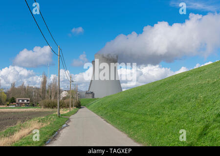 Cooling towers of Doel near Antwerp Belgium, with plenty of steam a a nice blue cloudy sky - Stock Photo