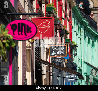 Shop and restaurant signs on historic Victoria Street in Edinburgh Old town, Scotland, UK - Stock Photo