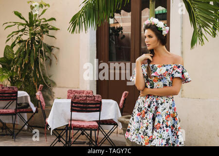 Happy woman in beautiful dress on the street of Havana city - Stock Photo