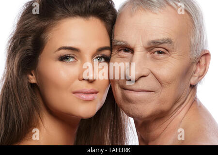 Happy elderly father and his beautiful daughter on white background - Stock Photo
