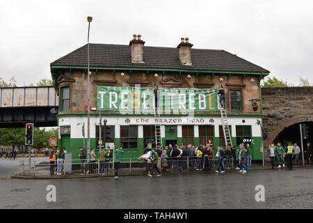 25th May, 2019. Glasgow, Scotland, UK, Europe. Scottish Cup winners, Celtic Football Club fans celebrate their achievement of three consecutive seasons of domestic trophies. The first time a domestic club has completed the triple treble in world football.The Brazen Head pub, a favourite bar for Celtic fans errected a large banner to celebrate the achievement soon after the game ended. - Stock Photo