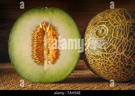 Galia melon, Cucumis melo, cut section showing flesh & seeds