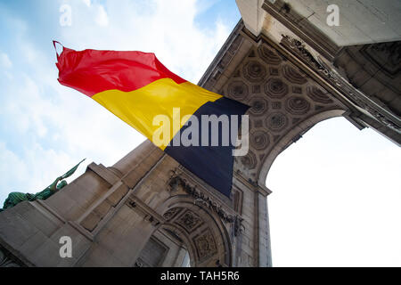 Belgian flag blowing Under an arch