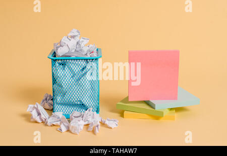 crumpled paper trash and stationary with empty paper placed in trash can - Stock Photo