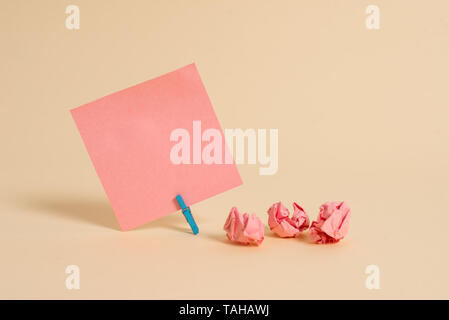 Plain note paper and stationary placed above soft pastel colour backdrop - Stock Photo
