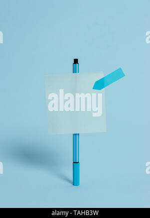 Ballpoint blank colored sticky note arrow banner peaceful cool background - Stock Photo
