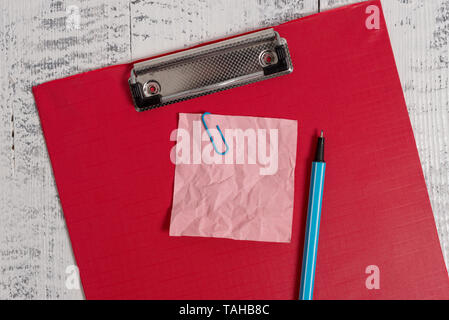 Colored clipboard crushed sticky note clip marker old wooden background - Stock Photo