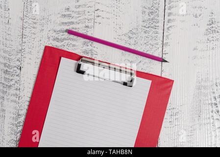 Colored clipboard blank paper sheet pencil old wooden vintage background - Stock Photo