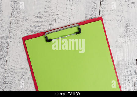Colored clipboard blank paper sheet old retro wooden vintage background - Stock Photo