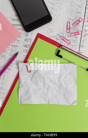 Clipboard sheet pencil smartphone note clips notepad wooden background - Stock Photo