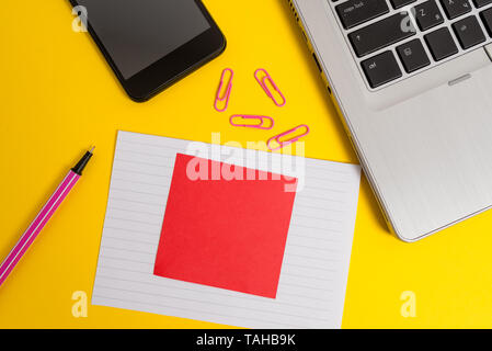 Trendy laptop smartphone marker paper sheet note clips colored background - Stock Photo
