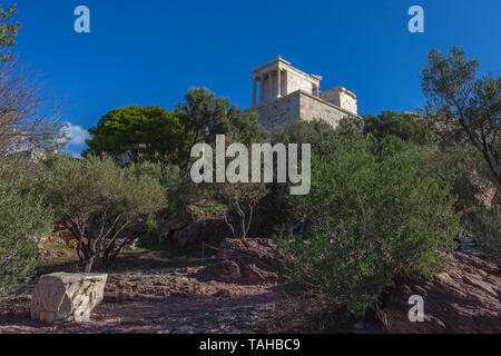 Woods surrounding the Acropolis with the Temple of Athena Nike in the background, Athens, Greece - Stock Photo