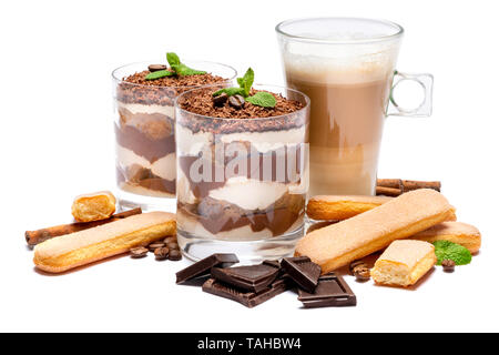Classic tiramisu dessert in a glass, savoiardi cookies and cup of coffee isolated on a white - Stock Photo