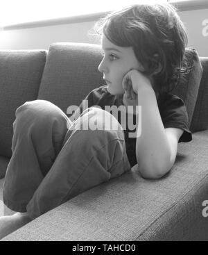 Child deep in thoughts - Stock Photo