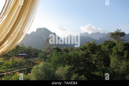 View from a restaurant on the karst hills landscape along Nam Song (Xong) river, Vang Vieng, Laos - Stock Photo