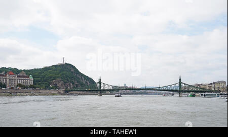 The Liberty Bridge or Szabadság híd Budapest connecting the Buda and Pest sides over the Danube looking towards Gellért Hill and the Gellért Hotel - Stock Photo
